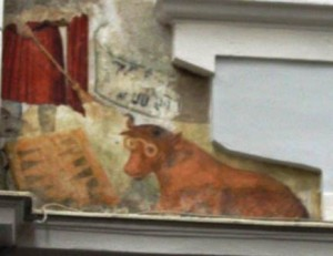 Let's see... a farsighted red cow reading strange runes while being shooed by a magical broom? Did I get that right?